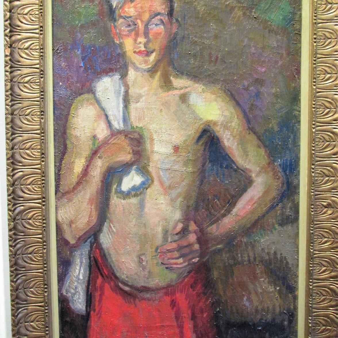 Kirpilä mies ylävartalo paljaana punainen pyyhe